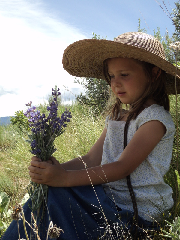 Calli with flowers at BoulderCrest Ranch