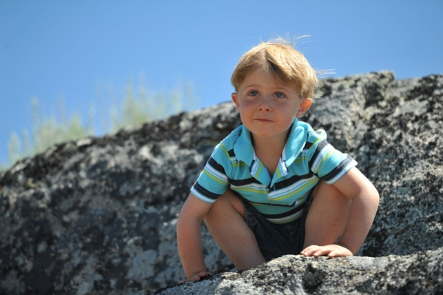 Adorable Kaeden on boulder at BoulderCrest Ranch