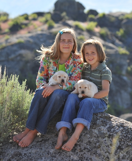 Tori and Calli with two Legacy Labrador puppies at BoulderCrest Ranch